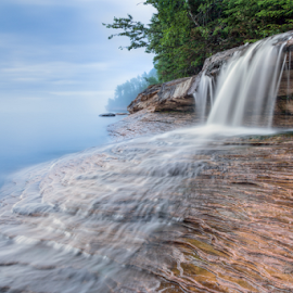 Elliot Falls at Nightfall by Kenneth Keifer - Landscapes Waterscapes ( rocky, waterfall, stone, sandstone, rock, blur, flow, nightfall, landscape, coast, nature, pictured rocks national lakeshore, cloudy, long exposure, evening, elliot falls, misty, clouds, flowing, twilight, lake, lake superior, forest, great lakes, scenic, dusk, woods, upper peninsula, blurred, michigan, foggy, splashing, miner's beach, fog, cascade, sundown, trees, cascading, whitewater, pictured rocks, ledges, mist )