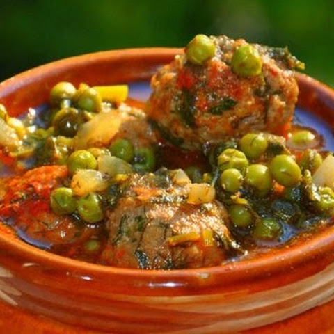 Meatballs In Sauce With Peas, Dill And Parsley