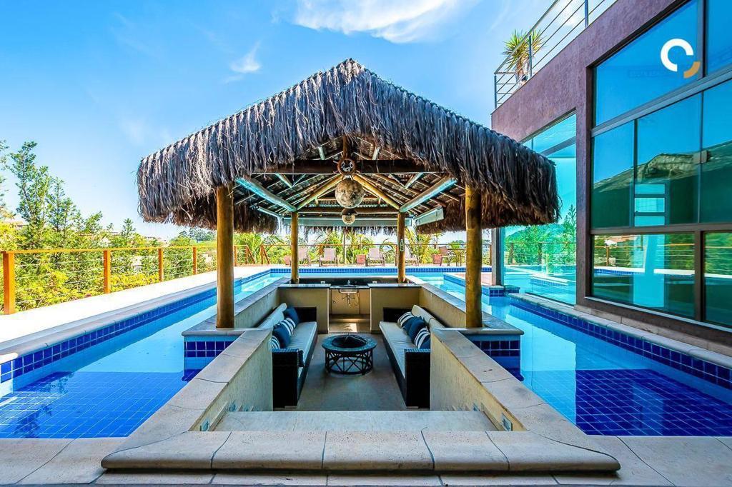 Condomínio Moinho de Vento   Casa mobiliada, fino acabamento, espaço gourmet, bar, piscina, sauna, 4 suítes e vista panorâmica. Valinhos/SP
