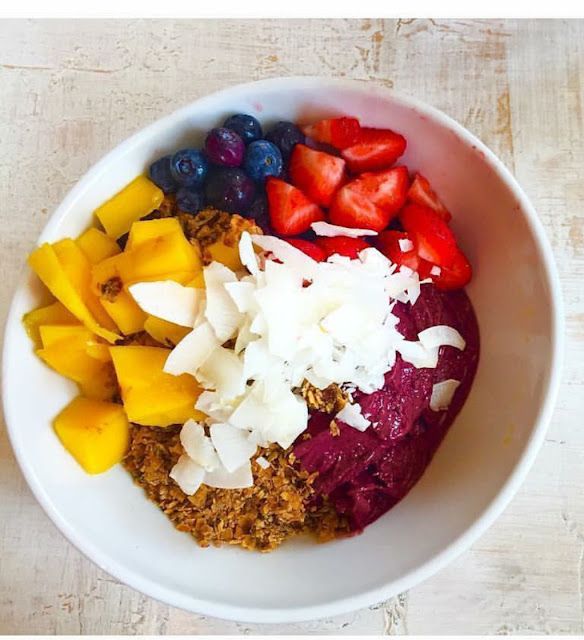 Acai Bowl with banana, house made granola, seasonal fruit, local honey and coconut flakes at Lilikoi Organic Living