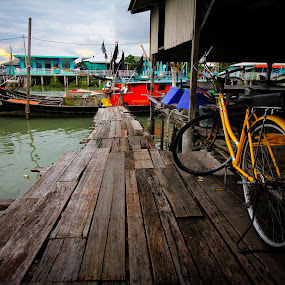 Fishing village neighborhood by Tan  Kian Yong - City,  Street & Park  Neighborhoods ( village, neighborhood, fishing, boat, rural, bicycle )