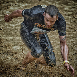 by Marco Bertamé - Sports & Fitness Other Sports ( water, brwon, 1308, splatter, differdange, splash, 2015, number, soup, running, luxembourg, muddy, strrong, strongmanrun, man )