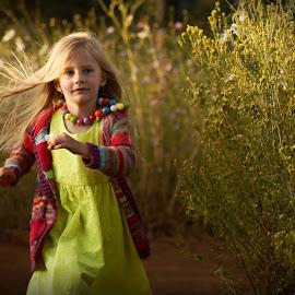 Kosmos run by Phillip Van Zyl - Babies & Children Toddlers ( wind, colourful, lush, children, fun, toddler, hair, running, flower,  )