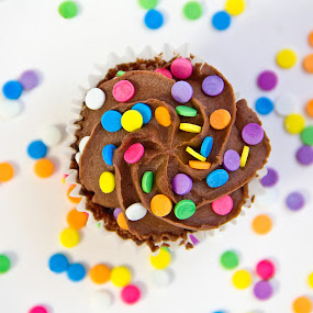 by Meaghan Browning - Food & Drink Candy & Dessert ( chocolate, sweet, cupcake, desert, cupcakes, colorful, sprinkles, bright, food, icing, delicious )
