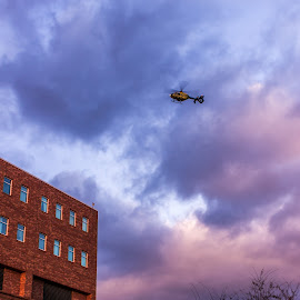 Medical Helicopter approaching rooftop landing pad by Todd Crenshaw - Transportation Helicopters ( helicopter, medical, landing, sunset, virginia )