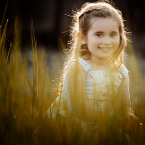 smile through the grass by Joseph Humphries - Babies & Children Child Portraits ( child, grass, sunset, happy, precious, hairlight, smile, natural, bokeh )
