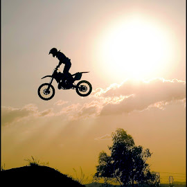 Icarus Flight by Craig McNiven - Transportation Motorcycles ( flight, bike, silhouette, motorcycle, stunt, sun,  )
