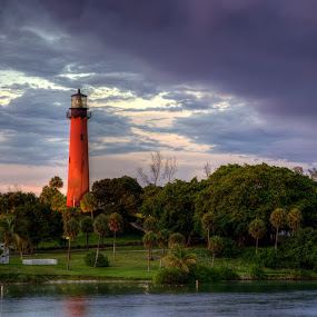 Jupiter Lighthouse at Sunset by Tim Azar - Landscapes Travel ( reflection, bright, jupiter inlet lighthouse & museum, brick, signal, architecture, sun, lantern, florida, glass, cloudy, marina, light, water, clouds, jupiter lighthouse, hdr, purple, lighthouse, jupiter inlet, jupiter, sunlight, tower, red, lighting, sunset, lamp, beacon, lantern room )