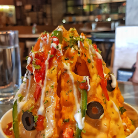 Nachos in a bowl by Chandni Tolani - Food & Drink Plated Food ( food and drink, nachos, yellow, food photography, food, cheese,  )