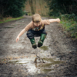 Everyone Likes Jumping Up and Down in Muddy Puddles by Dan Horton-Szar ARPS - Babies & Children Children Candids ( child, jumping, funny, fun, boy )