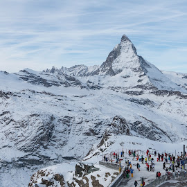 Zermatt, Valais, Switzerland by Serguei Ouklonski - Landscapes Mountains & Hills ( mountain, tranquil scene, travel, landscape, frozen, people, nature landscape, sky, nature, cold, cloud - sky, ice, snow, cold temperature, mountain peak, switzerland, weather, alp, snowcapped mountain, travel destinations, scenics, scenic, beauty in nature, large group of people, winter, mountain range, outdoors, tranquility, day, high, daylight )
