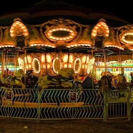 merry go round by Fraya Replinger - City,  Street & Park  Amusement Parks ( merry go round, amuement, park, spin, night )