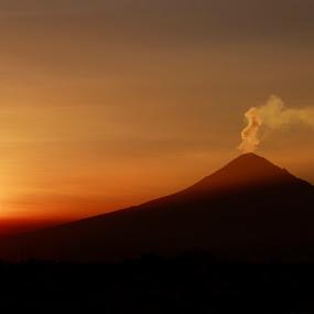 Smoking at sunset by Cristobal Garciaferro Rubio - Landscapes Sunsets & Sunrises ( cholula, sunset, mexico, smoking, puebla, popocatepetl, smoking volcano, sun )