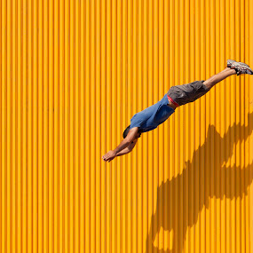 Illusion  by John CHIMON - Abstract Fine Art ( abstract, person, creative, jumping, male, art, dive, john, illusion, yellow, stripes, people, jump, modern, shadow, artistic, lines, me, diving )