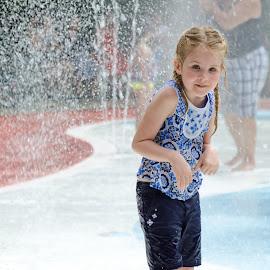 Water in the Air by David DeLoach - Babies & Children Children Candids ( blonde, girl, water park, summer, blue eyes, children candids, splash pad, KidsOfSummer )