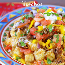 Breakfast Tater Totchos with Sunny Quail Eggs, Avocado & Chicken ...