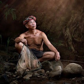 The Old Huntsman. by Jeerasak Chaisongmuang - People Portraits of Men ( fisherman thailand, senior citizen )