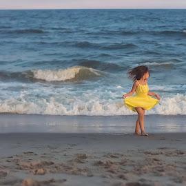 Beach beauty by Krystal Ferington-Timozek - Babies & Children Children Candids ( sand, little girl, girl, waves, sunset, dress, ocean, yellow, beach, pretty, KidsOfSummer )