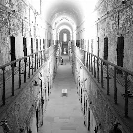 Eastern State Pen. by Amber Thomas - Buildings & Architecture Public & Historical ( railing, prison, black and white, hallway, prison cells )