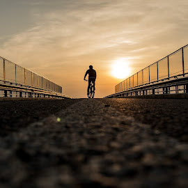 A cycler story by Jean Bogdan Dumitru - Sports & Fitness Cycling ( sunset, cycling, romania, bridge, road, evening )
