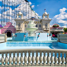 Riding the Sky by Michael Mounts - City,  Street & Park  Amusement Parks ( water, clouds, park, fountain, roller coaster )
