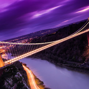 Clifton Suspension Bridge by Sinclair Parkinson - Buildings & Architecture Bridges & Suspended Structures ( water, gorge, suspension, avon, clifton, suspended, city, brunel, lights, urban, landmark, england, traffic, sky, trail, bridge, bridges, trails, light, bristol, river )