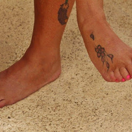 Feet with a tattoo  by Terry Linton - People Body Parts