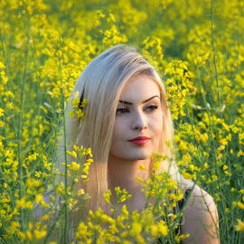 In the rape field by Radita Watkinson - People Portraits of Women