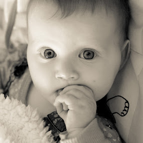 Hypnosis by Idan Presser - Babies & Children Child Portraits ( look, hypnosis, b&w, girl, sweet, fingers, baby, eyes )