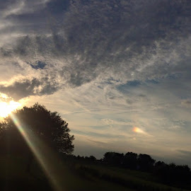 That's a Sundog to the right, a hole in the clouds casting rainbows!!!!:))) supposed to be some kind of goood Karma!!! What a sky at 7:00 tonight....BEAUTiful 💘💘💘 by Lori Wilson - Landscapes Cloud Formations