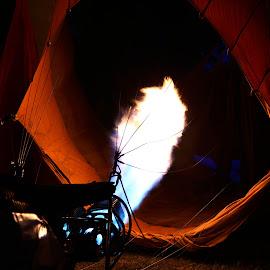 Firing up hot air balloon. by Paramasivam Tharumalingam - Abstract Fire & Fireworks
