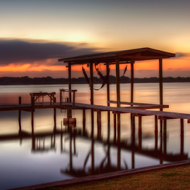 Sunset Dock by Tom Weisbrook - Landscapes Waterscapes ( water, eckert bayou, peaceful, calming, sunset, texas, reflections, pier, galveston, saltwater, dock )