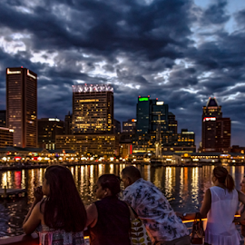 City Lights Cruise by Jackie Nix - City,  Street & Park  Skylines ( pink, baltimore, city, maryland, dusk, yellow, channel, tourism, skyline, clouds, scenic, towers, pier, postcard, inner harbor, cityscape, bay, dock, blue hour, sky, night, banner, skyscraper, downtown, boats, water, tour, office buildings, ships, panorama, attraction, outdoors, port, buildings, sunset, cruise, waterfront, purple, cloudscape, river, travel, sundown,  )