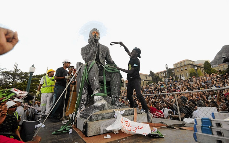 The statue of Cecil John Rhodes is removed from the University of Cape Town in April 2015.  Picture: MADS NORGAARD