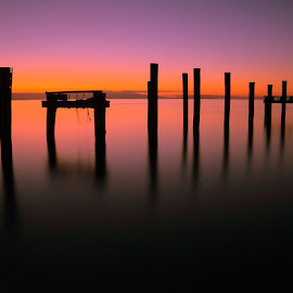 Disappearing by Ian McKellar - Buildings & Architecture Decaying & Abandoned ( water, calm, organge, purple, serene, sunset, sea, pier, dusk )