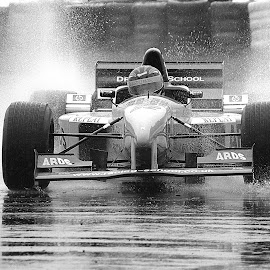 F1 In The Rain...... by Jacqueline Lancelotte - Sports & Fitness Motorsports ( splash, black and white, f1 car, rain )