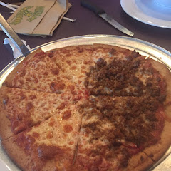 Yummy cheese pizza with half sausage