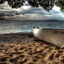 Boat on the beach by Zlatan Andrijašević - Landscapes Beaches ( clouds, croatia, sea, beach, dalmatia, landscape, boat )