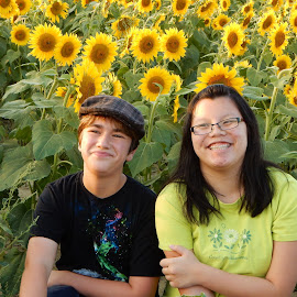 Flowers and Friendship by Kristine Nicholas - Novices Only Portraits & People ( glasses, oriental, teen, green, sunflowers, children, sunflower, teens, yellow, kids, chinese, hat, kid, asian, child, girl, teenager, teenagers, boy, flower )