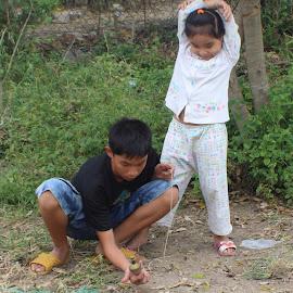 Spinner by Efraim Silver - Babies & Children Children Candids ( child, games, children, vietnamese, vietnam, people )