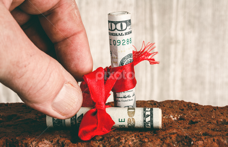Grab Life by the Bills by Rob Heber - Artistic Objects Other Objects ( gift, detail, wood grain backgroun, wood, brick, red ribbon, frayed, indoors, red brick, currency, hand, grabbing, reaching, ribbon, grasping, money, finances, closeup, wood grain, spending, financial, ideas, studio shot, texture, human hand, finger, gift wrapped, concepts, close up, twenty dollar bill, close-up, thumbnail, rough texture, paper money, cash, fingerprints, bow, rolled bills, conceptual, hundred dollar bill, thumb, bills )