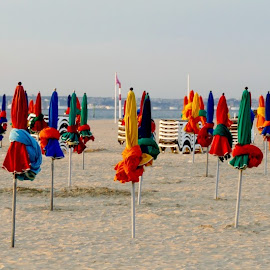sun umbrellas on the beach by Fred Goldstein - Landscapes Travel ( umbrellas, sunset, france, beach, deauville )