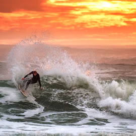 Sunset Surfer by Deon Warrington - Sports & Fitness Surfing ( storm, surfing, sunset, cloudscape, clouds )