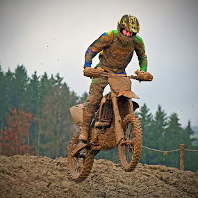 Jump Into The Mud by Marco Bertamé - Sports & Fitness Motorsports ( mud, rainy, motocross, clumps, race, jump, competition,  )