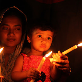 lights of hope  by Asif Mahmud - People Family ( affection, candid, bonding, cute, love, mother, candles, dark, candle light, night, baby, darkness, hope )