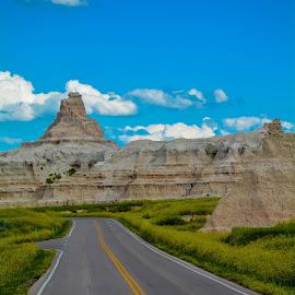 Badlands by Darrin Ralph - Landscapes Travel ( clouds, park, lanscape, south dakota, travel, road, badlands )