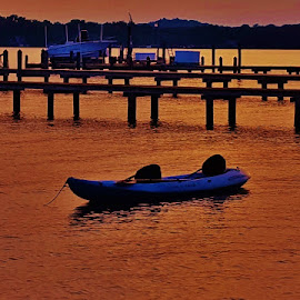 Kayak On The Magothy by Matthew Beziat - Transportation Boats ( magothy river, boats, kayak, boat, boating, pasadena, sunset, sunsets, anne arundel county, maryland, pasadena maryland, waterfront, evening )
