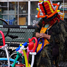 Balloon man by Gaylord Mink - City,  Street & Park  Street Scenes ( vendor, balloon man, street scene, balloons, man )