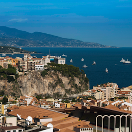 View of Monaco by Deyan Georgiev - Landscapes Travel ( principality, port, famous, riviera, europe, harbor, ship, yacht, monaco, travel, architecture, french, seaside, coastline, landscape, coast, city, sky, sailing, mediterranean, lifestyle, buildings, france, marina, azure, sightseeing, water, building, rich, boats, sea, tourism, scenic, boat, yachts, holiday, luxury, urban, vacation, european, blue, bay, wealth, monte carlo, casino, scenery, view )