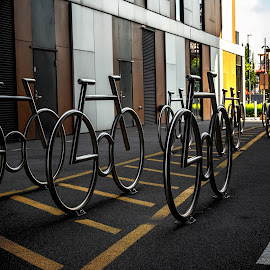 Bicycles parking by Jørgen Schei - City,  Street & Park  Street Scenes ( bicycles parking, street art, art, bicycle, street, street photography, street scenes )